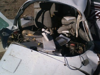 A look into the cockpit. The plexiglass is scatered around the wreckage.